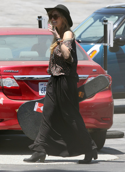 Delta Goodrem worked a boho vibe in a long black skirt and a floral off-the-shoulder top while heading to Capitol Records in Hollywood.
