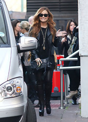 Demi Lovato stepped out in London wearing a pair of black platform knee high boot with her black leather leggings and jacket.