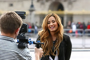 Demi Lovato spend an afternoon out and about in London wearing her long lightened locks in tousled waves.