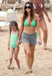Actress Denise Richards added some color with this bright green halter top bikini.