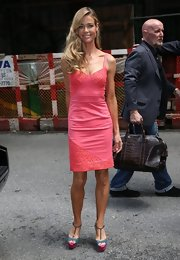 Denise Richards looked pretty in pink in this fitted cocktail dress, which she wore to a taping of 'The Chew.'