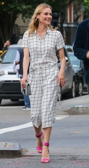 Diane Kruger punched up her look with a pair of hot-pink ankle-cuff sandals by Nicholas Kirkwood.