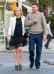 Diane Kruger completed her street-chic look with a cute pair of bow-adorned peep-toe booties by Chanel.