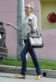 Diane Kruger looked casual but comfy in a loose-weave crewneck sweater while grabbing coffee with a friend.