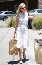 Diane Kruger dressed up for her shopping trip when she donned this sleeveless white embroidered dress.