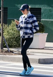 Diane Kruger balanced out her bulky jacket with sexy black leggings.