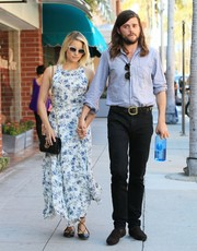 Dianna Agron took a stroll in Beverly Hills wearing a sweet floral maxi dress.