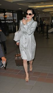 Dita Von Teese looked glam at the airport with a white quilted Chanel flap bag on her arm.