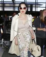 Dita Von Teese made her way through LAX wearing a pair of white-rimmed butterfly sunnies.