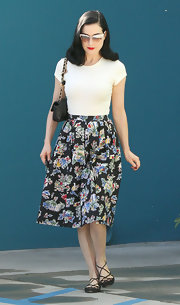 Dita Von Teese finished off her floral skirt with strappy ballet flats.