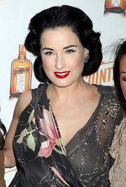 Dita Von Teese showcased her signature retro style at the launching of her Cointreau MagaDita cocktail event. She amped up her look with ravishing red lipstick.