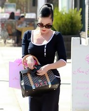 Just an average day out and about and Dita Von Teese is as polished and put together as ever.  As always her sleek updo is pinned perfectly into place.