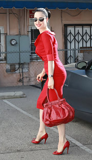 Dita Von Teese went all red out in Hollywood, completing her look with this patent croc tote.