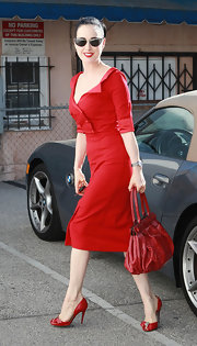 Dita Von Teese stepped out in West Hollywood wearing a pair of shiny red peep toe pumps with sparkly accents.