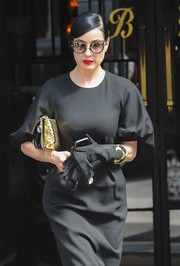 Dita Von Teese looked vintage-chic in black suede gloves and an LBD while out and about in New York City.