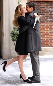The pregnant supermodel covered her baby bump with a long wool coat and sported a super high pair of black pumps.