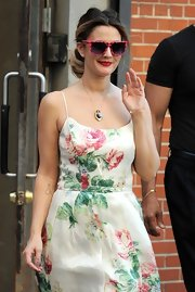 Drew Barrymore showed off her summer colors in a cute floral frock and a heart pendant necklace.