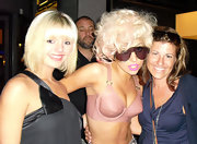 Lady Gaga posed with fans after preforming on stage in a latex bra.