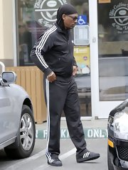 Eddie Murphy showed his sporty side in LA when he stepped out in a black track jacket and matching pants.