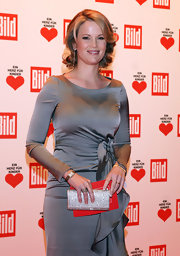 Stephanie amped up the glitz factor with a sparkling envelope clutch at a charity gala in Germany.