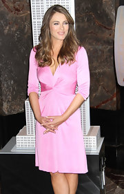 Elizabeth Hurley looked like a Barbie doll in this bubble gum pink cocktail dress on top of the Empire State Building.