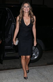 Elizabeth Hurley styled her dress with a pair of embellished black peep-toes.