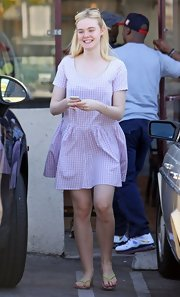 Elle showed off her feminine and flirty side with this gingham frock.