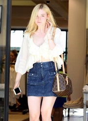 Elle Fanning went shopping in LA carrying a stylish Louis Vuitton monogram bag.