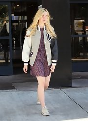 Elle Fanning paired her floral dress with Converse sneakers.