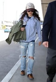 Ellen Page opted for distressed denim for her casual travel look.