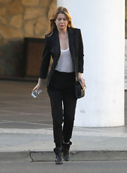 Ellen Pompeo added structure to her look in a black blazer and sheer white tank.