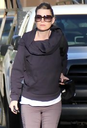Ellen's flattering oversized shades have a fading rose tinted lens that is great on her.