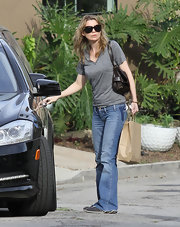 Ellen Pompeo ran errands in light flares and comfortable sneakers.