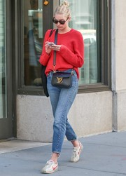 Elsa Hosk kept cozy in a slouchy red sweater while out and about in New York City.
