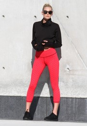 Elsa Hosk showed off her slim pins in a pair of red leggings.