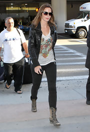 Emily Blunt rocked a black leather bomber over her printed tee.