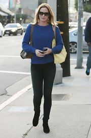 Emily Blunt favored a more classic look with this bright blue crewneck paired with black skinny jeans.