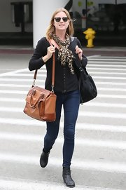 Emily stuck to a classic preppy look when she donned this black cardigan.