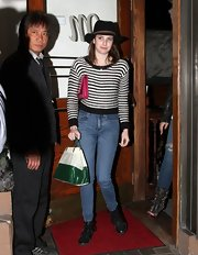 Emma Roberts showed her funky, hippie style with this black walker hat with brown strap.
