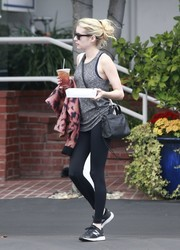 Emma Roberts teamed her tank with black leggings.