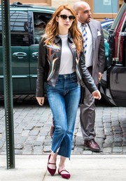 Emma Roberts cut a stylish figure in a Tory Burch floral leather jacket teamed with capri jeans while strolling in New York City.