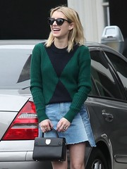 Emma Roberts paired a green and black sweater with a denim mini skirt for a day of shopping in Beverly Hills.