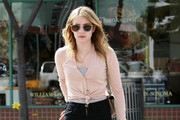 Actress Emma Roberts chatting on the phone while running some errands in Beverly Hills, CA.