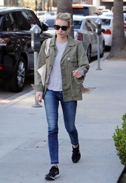 Emma Roberts went for a tough finish with a taupe military jacket by American Eagle Outfitters.
