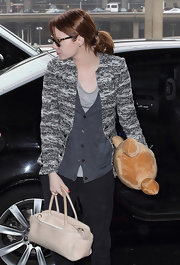 Emma Stone enhanced her casual outfit with an eye-catching tweed  sweater.