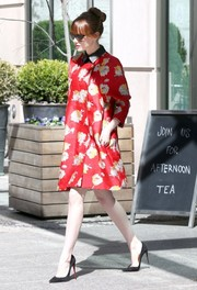 Emma Stone brought some vintage glamour to the streets of New York City with this floral jacquard coat by Brock.