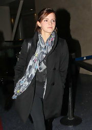 Emma Watson threw on this abstract print scarf with her black ensemble at LAX.