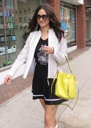 Emmy Rossum brightened up her monochrome outfit with a yellow cross-body tote while out and about in Beverly Hills.