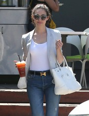 Emmy Rossum styled her jeans with a chic Hermes leather belt.