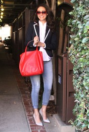 Emmy Rossum completed her shopping ensemble with a simple yet stylish red CH Carolina Herrera leather tote.